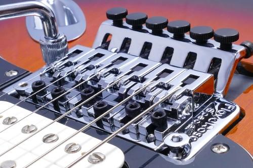 tune an electric guitar