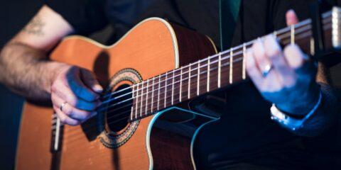 How to strum a guitar